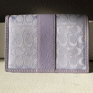 Authentic Coach Signature Lilac Leather Wallet.